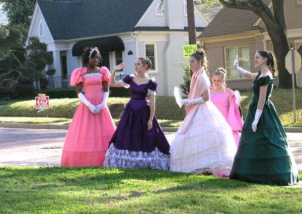 Tyler belles in period costume welcome visitors