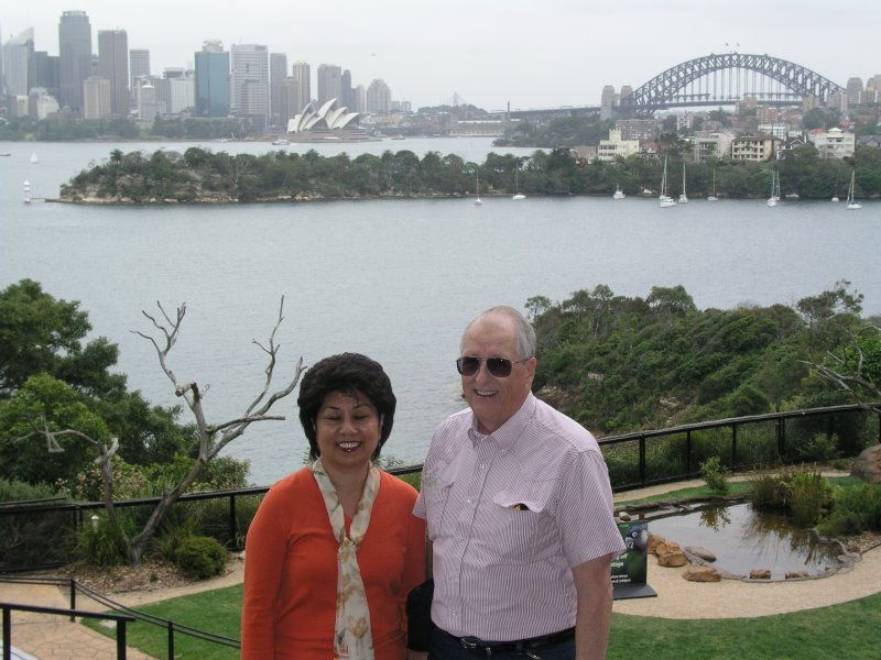 Angie and Jim Harrison at the Toranga Zoo with Sydney in the background