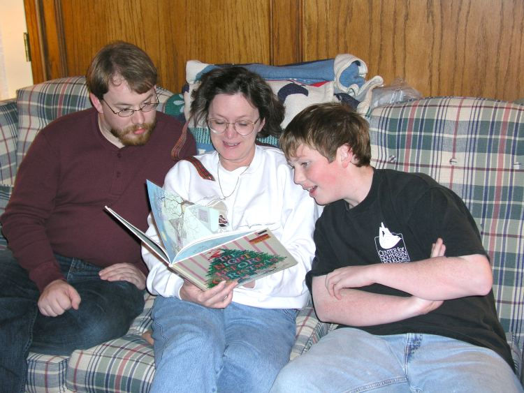 "Mama reads ""The Night Before Christmas"" to her boys"