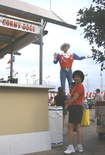 Angie contemplates a Fletcher's Corny Dog at the State Fair